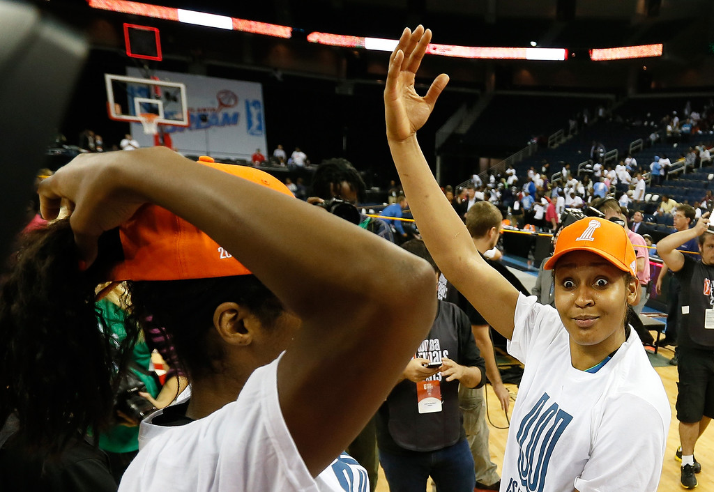 . ATLANTA, GA - OCTOBER 10:  Maya Moore #23 and Devereaux Peters #14 of the Minnesota Lynx celebrate their 86-77 win over the Atlanta Dream in Game Three of the 2013 WNBA Finals at Philips Arena on October 10, 2013 in Atlanta, Georgia. (Photo by Kevin C. Cox/Getty Images)