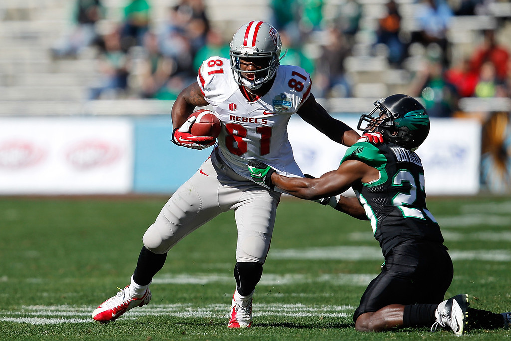 . DALLAS, TX - JANUARY 01: Devante Davis #81 of the UNLV Rebels runs against Zac Whitfield #23 of the North Texas Mean Green during the Heart of Dallas Bowl at Cotton Bowl Stadium on January 1, 2014 in Dallas, Texas.  (Photo by Sarah Glenn/Getty Images)