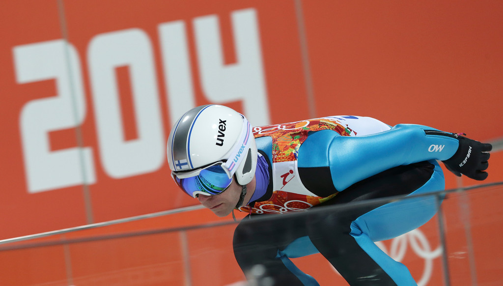 . Finland\'s Janne �Ahonen starts an attempt during the men\'s normal hill ski jumping qualification at the 2014 Winter Olympics, Saturday, Feb. 8, 2014, in Krasnaya Polyana, Russia. (AP Photo/Matthias Schrader)