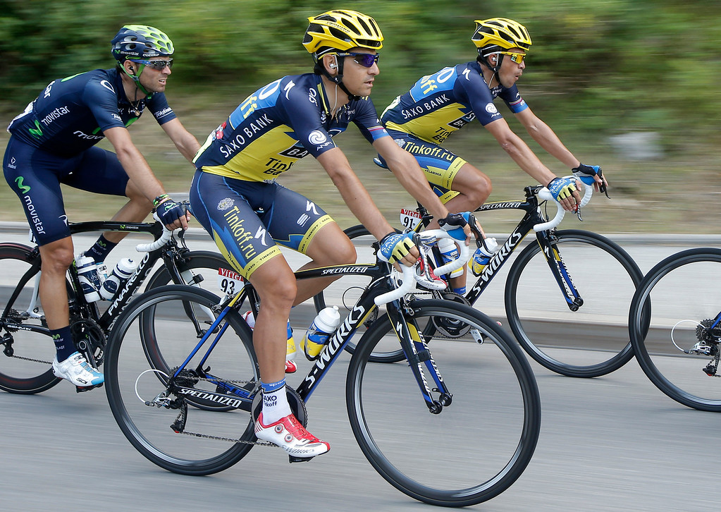 . Spain\'s Alejandro Valverde, Jesus Hernandez Blazquez and teammate Alberto Contador of Spain, ride in the pack during the sixteenth stage of the Tour de France cycling race over 168 kilometers (105 miles) with start in in Vaison-la-Romaine and finish in Gap, France, Tuesday July 16, 2013. (AP Photo/Laurent Cipriani)