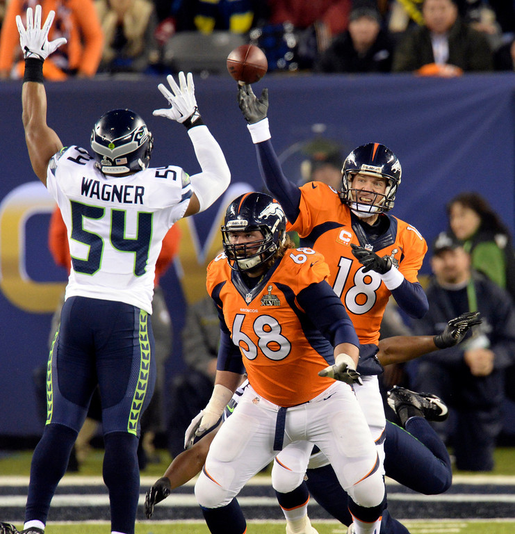 . Denver Broncos quarterback Peyton Manning (18) throws an interception.  The interception was pulled in by Seattle Seahawks strong safety Kam Chancellor (31). The Denver Broncos vs the Seattle Seahawks in Super Bowl XLVIII at MetLife Stadium in East Rutherford, New Jersey Sunday, February 2, 2014. (Photo by Hyoung Chang//The Denver Post)