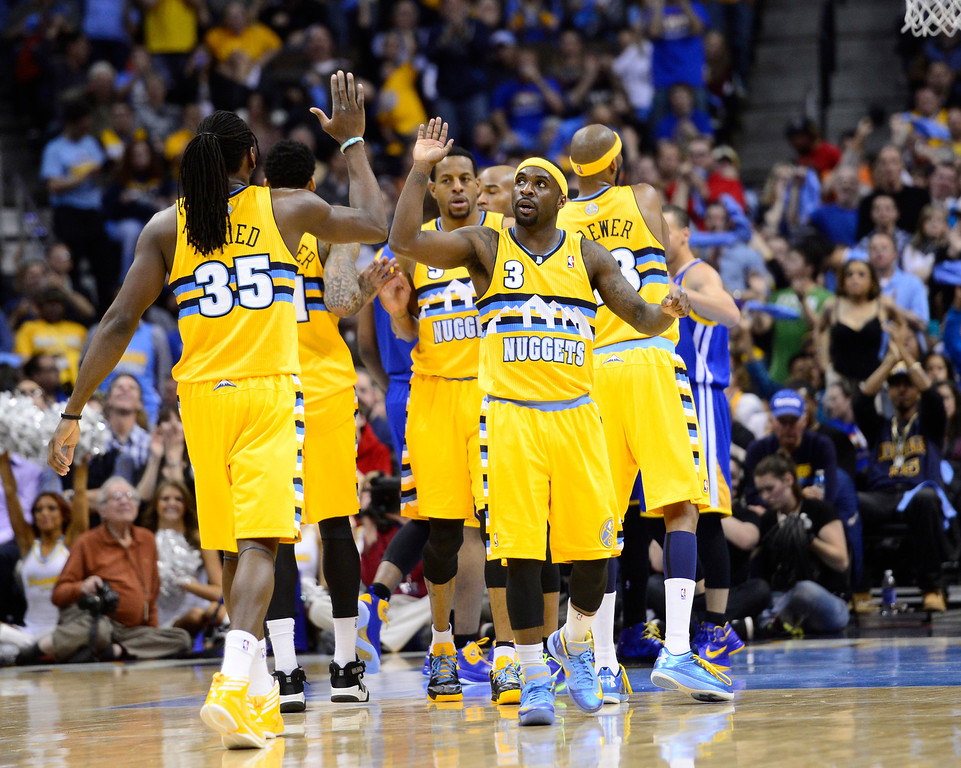 . DENVER, CO. - APRIL 23: Denver Nuggets point guard Ty Lawson (3) celebrates with Denver Nuggets small forward Kenneth Faried (35) in the second quarter. The Denver Nuggets took on the Golden State Warriors in Game 2 of the Western Conference First Round Series at the Pepsi Center in Denver, Colo. on April 23, 2013. (Photo by AAron Ontiveroz/The Denver Post)