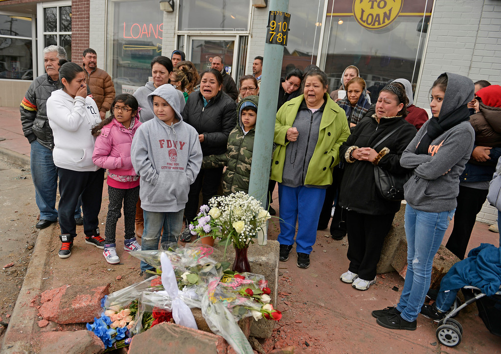 . Friends and family gather at the corner of East Colfax Avenue and Dayton Street in Aurora where Juan Carlos Dominguez-Palomino was killed earlier in a fatal crash, Monday, March 24, 2014. Dominguez-Palomino, a 17-year-old driver of a Chevy Camaro, was killed when the driver of a Ford Expedition slammed into his vehicle, Aurora police said. Excessive speed and alcohol are suspected to have contributed to the crash. (Photo by RJ Sangosti/The Denver Post)