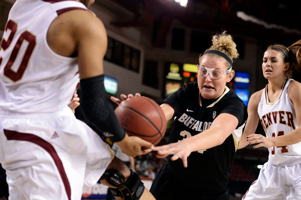 . University of Colorado\'s Jen Reese fights for a loose ball with Maiya Michel during a games against the University of Denver on Tuesday, Dec. 11, at the Magnus Arena on the DU campus in Denver.   (Jeremy Papasso/Daily Camera)