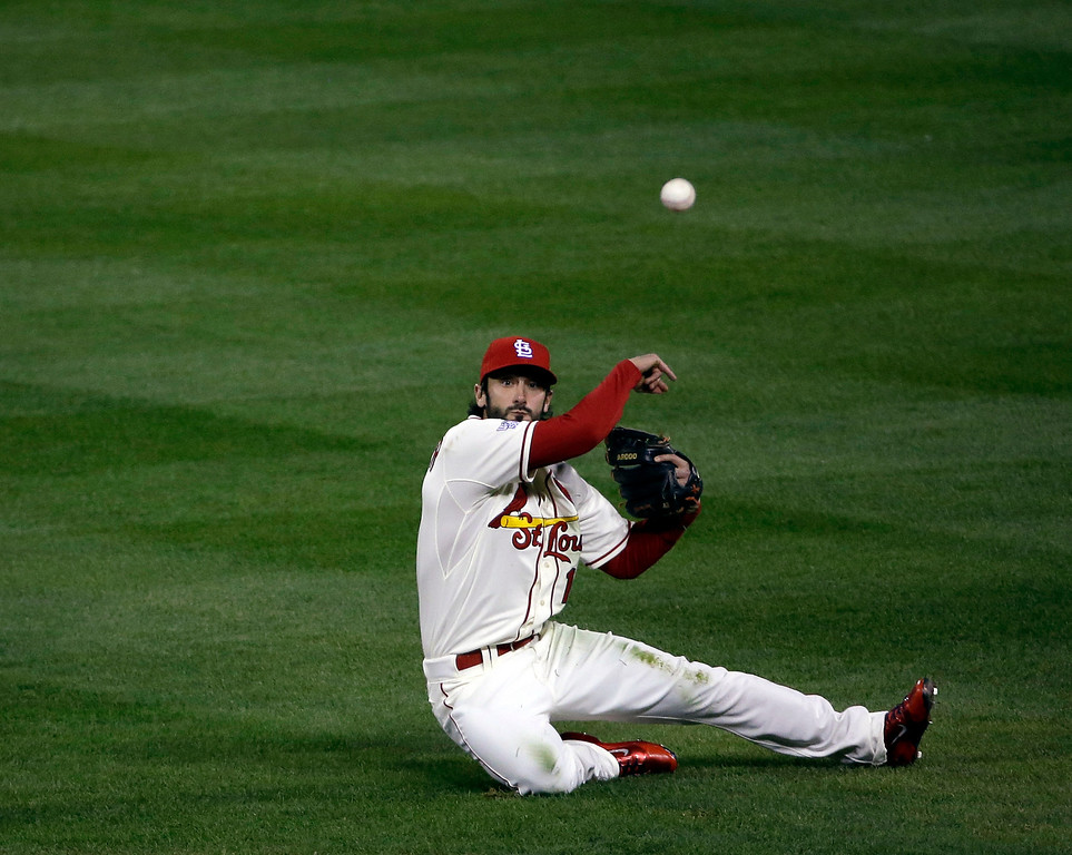 . St. Louis Cardinals second baseman Matt Carpenter throws out Boston Red Sox\'s Daniel Nava from his knees during the second inning of Game 3 of baseball\'s World Series Saturday, Oct. 26, 2013, in St. Louis. (AP Photo/David J. Phillip)