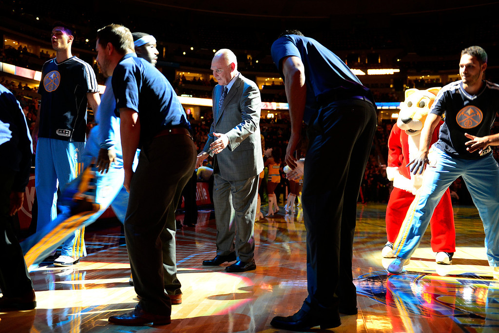 . Denver Nuggets head coach George Karl high fives point guard Ty Lawson (3) as he introduced during the first half at the Pepsi Center on Monday, December 3, 2012. AAron Ontiveroz, The Denver Post