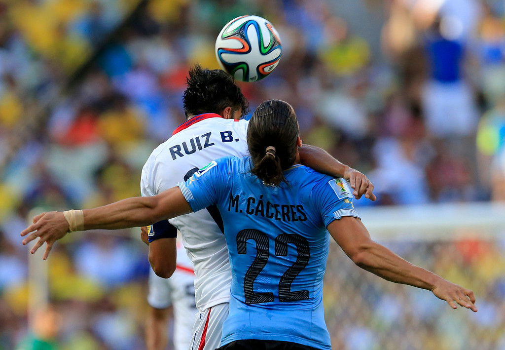 . Uruguay\'s Martin Caceres and Costa Rica\'s Bryan Ruiz battle for the ball during the group D World Cup soccer match between Uruguay and Costa Rica at the Arena Castelao in Fortaleza, Brazil, Saturday, June 14, 2014.(AP Photo/Bernat Armangue)