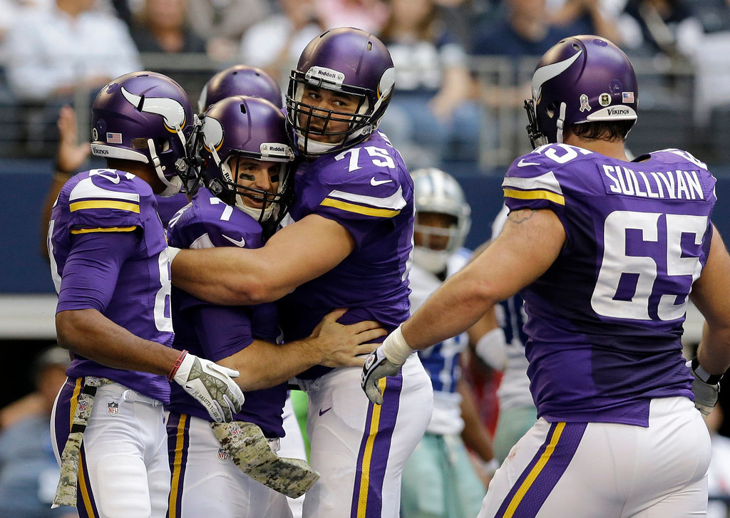 . Minnesota Vikings\' Jerome Simpson, left, John Sullivan (65) and Matt Kalil (75) celebrate the touchdown run by Christian Ponder, second from left, in the first  half of an NFL football game against the Dallas Cowboys, Sunday, Nov. 3, 2013, in Arlington, Texas. (AP Photo/Nam Y. Huh)