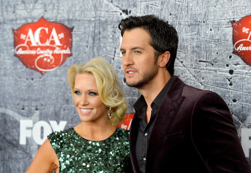 . LAS VEGAS, NV - DECEMBER 10:  Singer Luke Bryan (R) and his wife Caroline Boyer arrive at the 2012 American Country Awards at the Mandalay Bay Events Center on December 10, 2012 in Las Vegas, Nevada.  (Photo by Frazer Harrison/Getty Images)