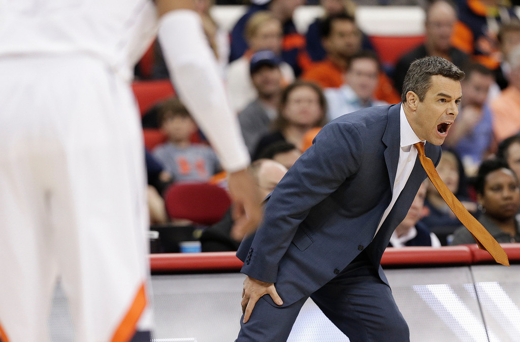 . Virginia head coach Tony Bennett speaks to his players during the first half of an NCAA college basketball third-round tournament game against Memphis, Sunday, March 23, 2014, in Raleigh. (AP Photo/Chuck Burton)
