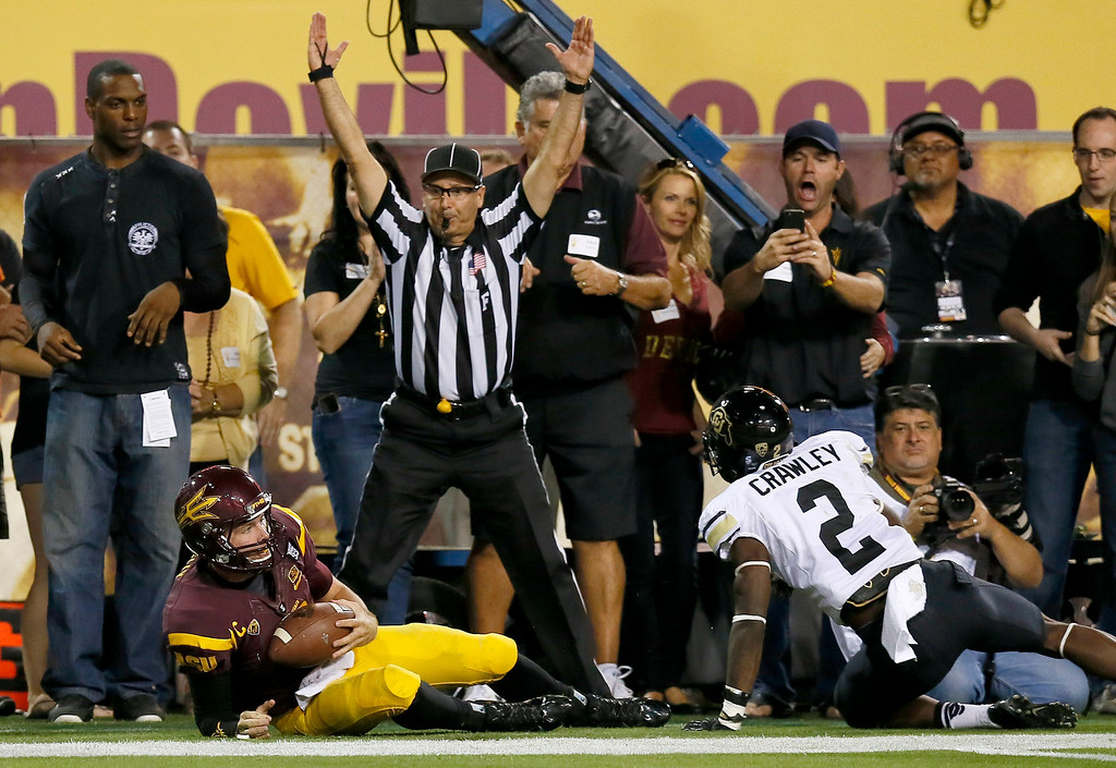 . Arizona State\'s Taylor Kelly, bottom left, hangs on to the football as he beats Colorado\'s Kenneth Crawley (2) to the end zone as field judge Steven Strimling signals for the touchdown during the first half of an NCAA college football game on Saturday Oct. 12, 2013, in Tempe, Ariz. (AP Photo/Ross D. Franklin)