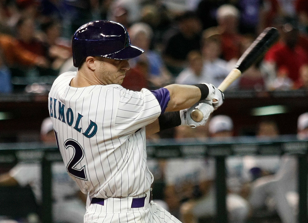 . Arizona Diamondbacks\' Nolan Reimold (12) singles in the ninth inning during a baseball game against the Colorado Rockies, Saturday, Aug. 30, 2014, in Phoenix. (AP Photo/Rick Scuteri)