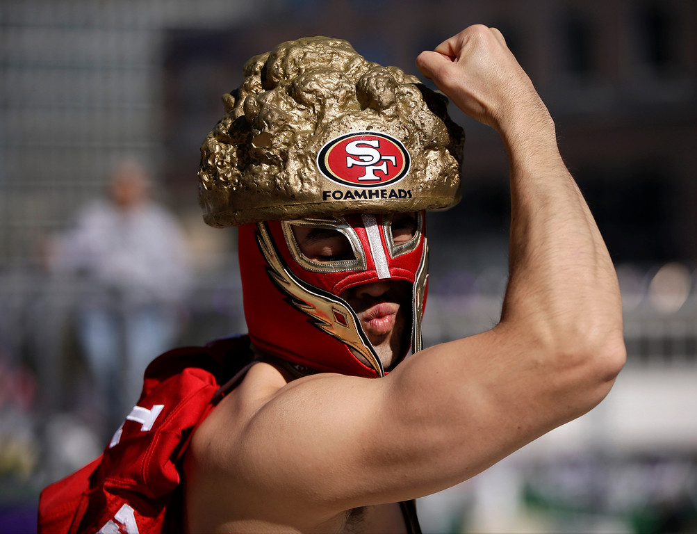 . A San Francisco 49ers fan poses for photos before the NFL Super Bowl XLVII football game between the 49ers and the Baltimore Ravens, Sunday, Feb. 3, 2013, in New Orleans. (AP Photo/Mark Humphrey)