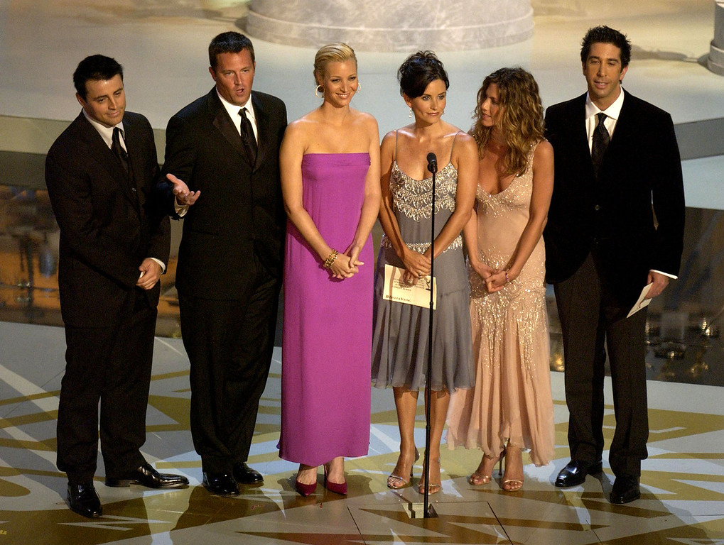 . (L to R) Actors Matt LeBlanc, Matthew Perry, Lisa Kudrow, Courteney Cox Arquette, Jennifer Aniston and David Schwimmer present an award during the 54th Annual Primetime Emmy Awards at the Shrine Auditorium on September 22, 2002 in Los Angeles, California.  (Photo by Vince Bucci/Getty Images)
