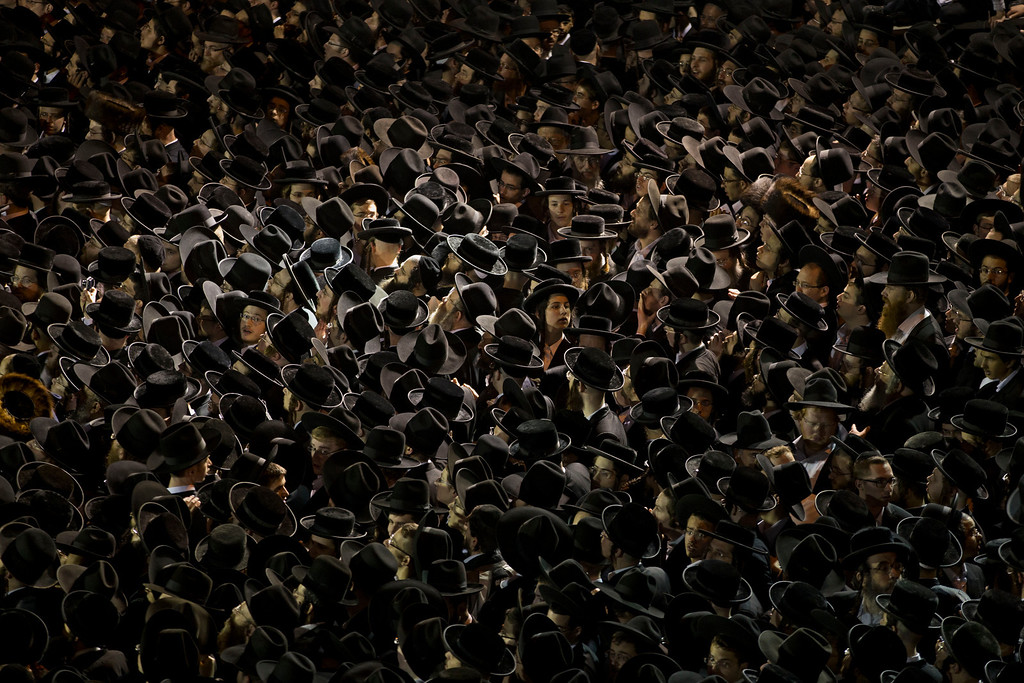 . Thousands of ultra-orthodox jews gather near an Israeli Defense Forces recruitment center during a protest against military conscription of yeshiva students, in Jerusalem, Thursday, May 16, 2013. (AP Photo/Bernat Armangue)