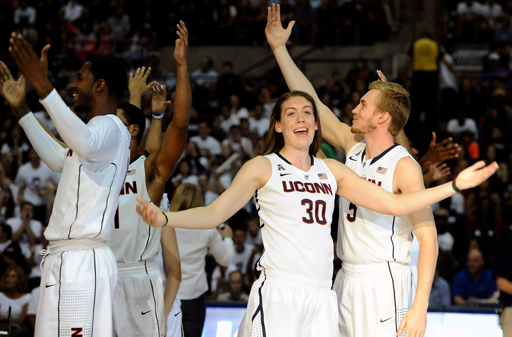 . Connecticut\'s Breanna Stewart (30) rallies the audience with her inter-squad team during the at the men\'s and women\'s basketball teams\' First Night event in Friday, Oct. 18, 2013, in Storrs, Conn. (AP Photo/Jessica Hill)