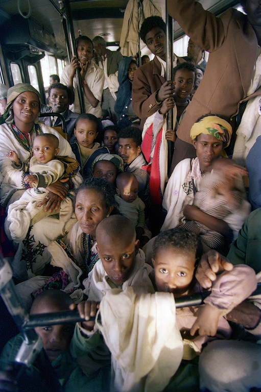 ". ADDIS ABEBA, ETHIOPIA:  Ethiopian Jews, known as ""Falasha\"", are bussed from the Israeli embassy to the Addis Ababa airport, 24 May 1991, as part of the world\'s largest airlift. Israel started airlifting some 18,000 Ethiopian Falasha Jews with the assistance of the United States as rebel pressure on the capital increases. JEROME DELAY/AFP/Getty Images"