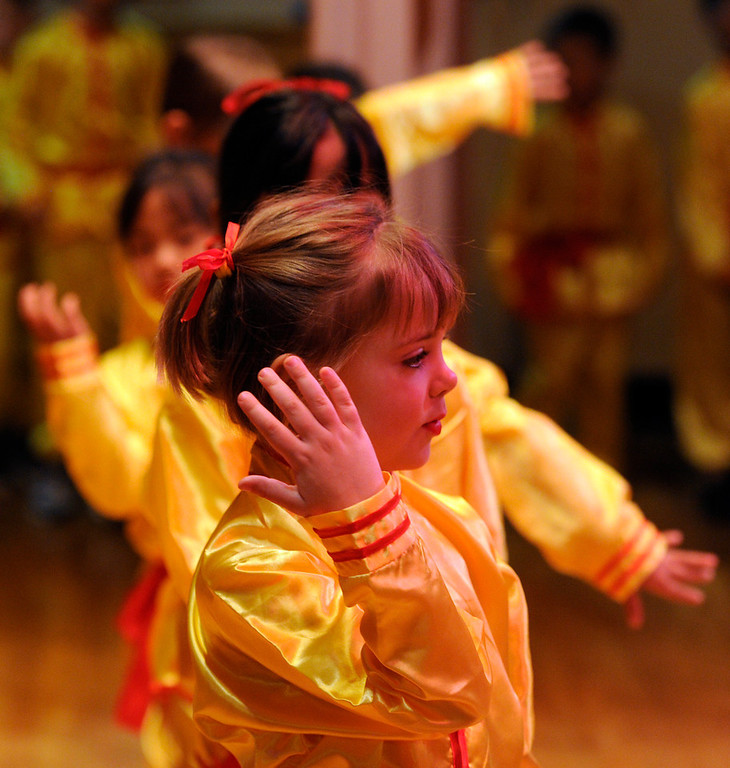. A second grade class performs the Zhong Guo Gong Fu dance. Students at the Denver Language School ring in the Year of the Snake with their Chinese New Year celebration performance in the school auditorium. Kindergarteners through 4th grade perform traditional dances dressed in colorful Chinese costumes. According to the school principal, Chinese New Year is the most important of the traditional Chinese holidays. Families make way for  good luck by cleaning their homes symbolizing reconciliation and forgetting old grudges in exchange for peace and happiness. The Chinese New Year (Feb. 10) follows the Chinese 12 Zodiac Calendar Year designating 2013 the Year of the Snake. (Photo By Kathryn Scott Osler/The Denver Post)