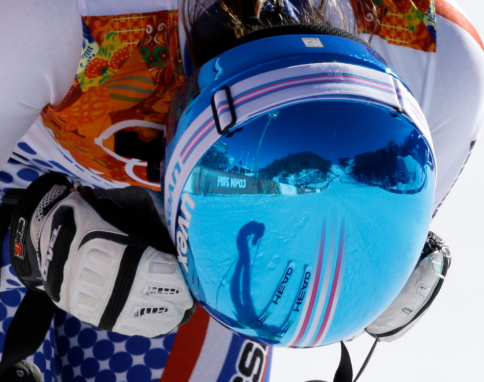 . Russia\'s Maria Bedareva rests after finishing the women\'s downhill at the Sochi 2014 Winter Olympics, Wednesday, Feb. 12, 2014, in Krasnaya Polyana, Russia. (AP Photo/Kirsty Wigglesworth)