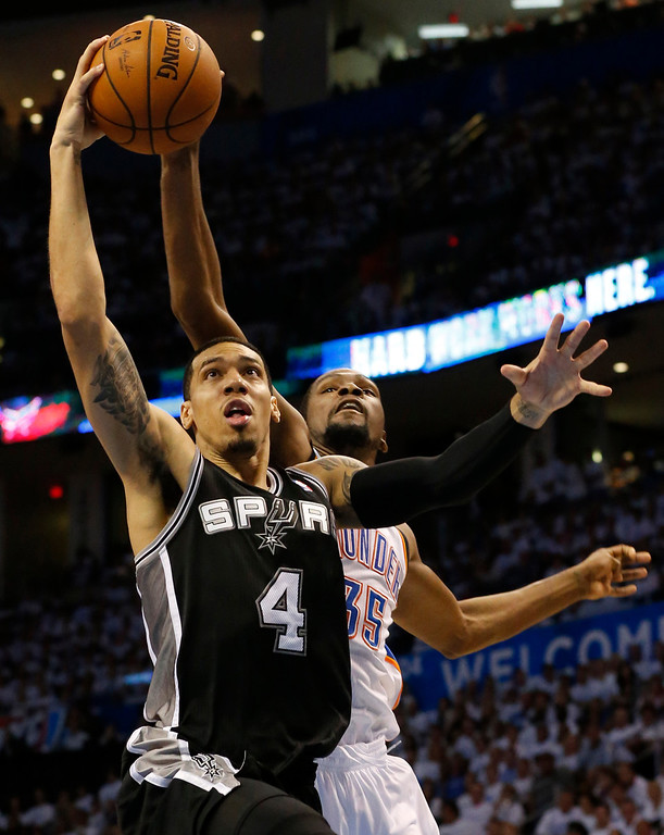 . San Antonio Spurs guard Danny Green (4) has his shot blocked by Oklahoma City Thunder forward Kevin Durant (35) during the second half of Game 6 of the Western Conference finals NBA basketball playoff series in Oklahoma City, Saturday, May 31, 2014. (AP Photo/Sue Ogrocki)