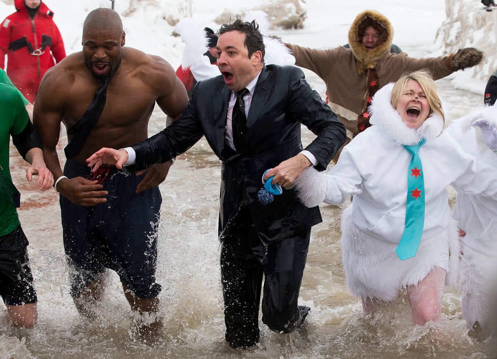 """. \""""The Tonight Show\"""" host Jimmy Fallon, center, exits the water during the Chicago Polar Plunge, Sunday, March 2, 2014, in Chicago. Fallon joined Chicago Mayor Rahm Emanuel in the event. (AP Photo/Andrew A. Nelles)"""