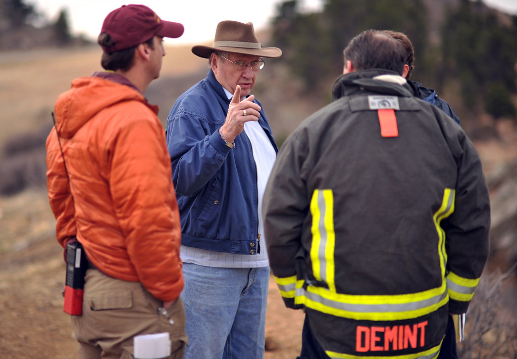 . FORT COLLINS, CO. - MARCH 16: Evacuee Doyle Smith, center, asks questions to Tony Simons, wildfire Safety Specialist of Larimer County, left, and Tom Demint, Fire Chief of Poudre Fire Authority. The Galena wildfire in Larimer County pushed west overnight through Lory State Park, driven by wind gusts reaching 45 mph. The fire is still at 5 percent containment. Fort Collins, Colorado. March 16, 2013. (Photo By Hyoung Chang/The Denver Post)