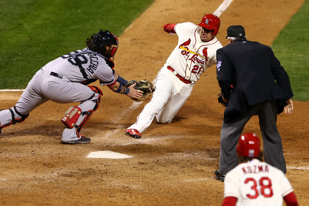 . ST LOUIS, MO - OCTOBER 26:  Allen Craig #21 of the St. Louis Cardinals scores on a feilder\'s choice by Jon Jay #19 in the ninth inning as Jarrod Saltalamacchia #39 of the Boston Red Sox ateempts to make the tag during Game Three of the 2013 World Series at Busch Stadium on October 26, 2013 in St Louis, Missouri.  (Photo by Elsa/Getty Images)