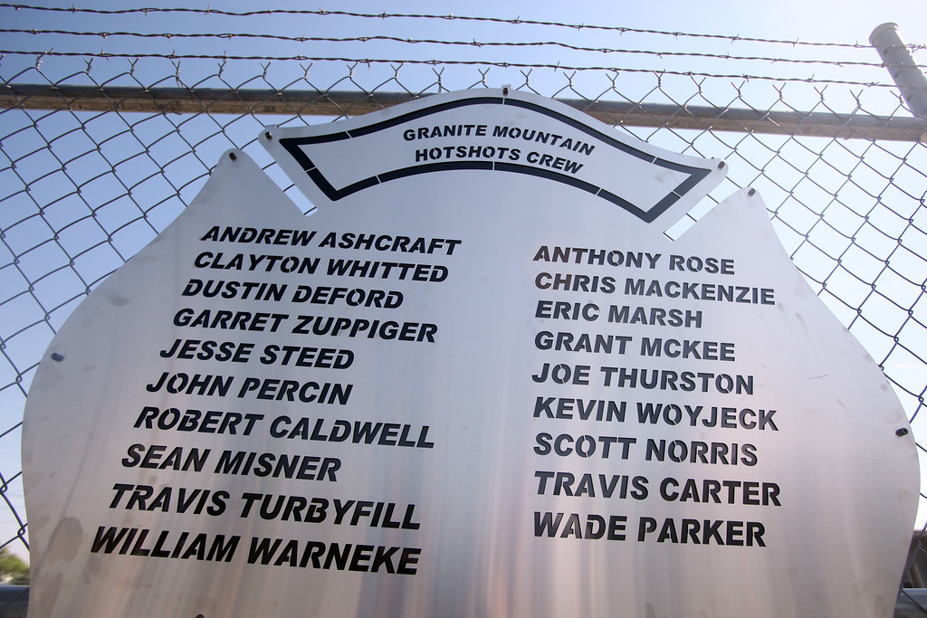 . A plaque engraved with names of the 19 fallen firefighters is mounted on a fence outside of Granite Mountain Hotshots Fire Station 7 in Prescott, Arizona July 2, 2013.   AFP PHOTO / KRISTA  Kennell/AFP/Getty Images