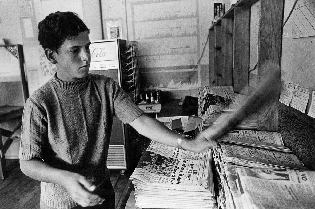 . Denver Post carrier salesman David Hunt, 14, checks and folds his papers at the District 21 station prior to delivering to his 145 subscribers. He\'s a South High School Sophomore. September 1970.  (Photo by Olivia Fall/The Denver Post Archive)