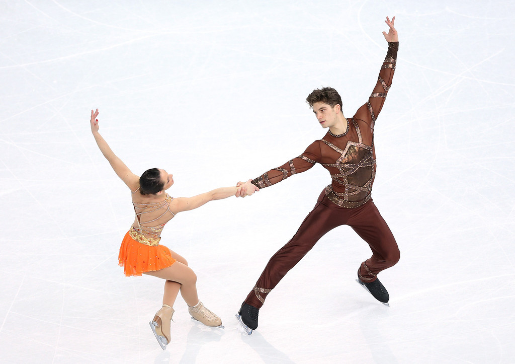 Description of . Nicole Della Monica and Matteo Guarise of Italy compete during the Figure Skating Pairs Short Program on day four of the Sochi 2014 Winter Olympics at Iceberg Skating Palace on February 11, 2014 in Sochi, Russia.  (Photo by Matthew Stockman/Getty Images)