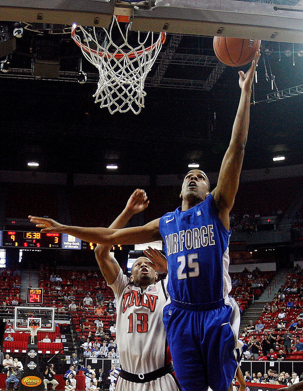 . Air Force\'s Kyle Green (25) shoots over UNLV\'s Bryce Dejean-Jones (13) during the first half of a Mountain West Conference tournament NCAA college basketball game, Wednesday, March 13, 2013, in Las Vegas. UNLV won 72-56. (AP Photo/Isaac Brekken)
