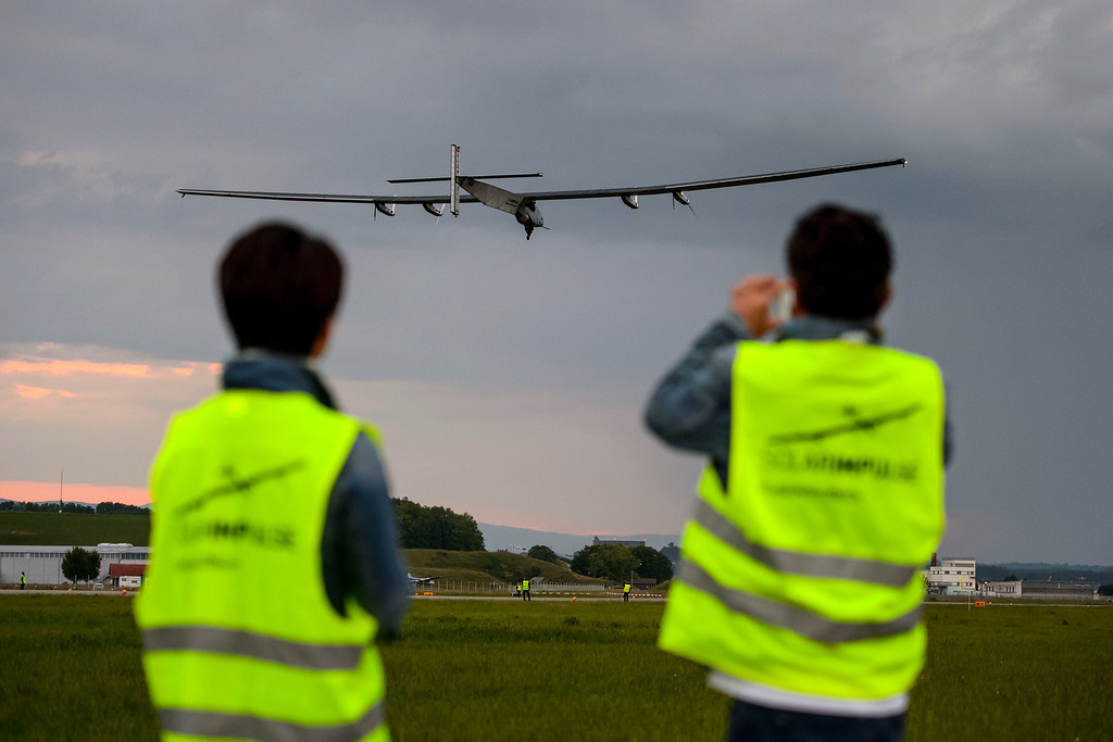 . The solar-powered Solar Impulse 2 aircraft  takes off during its first  flight Monday, June 2, 2014 in Payerne, Switzerland.    (AP Photo/Fabrice Coffrini, pool)