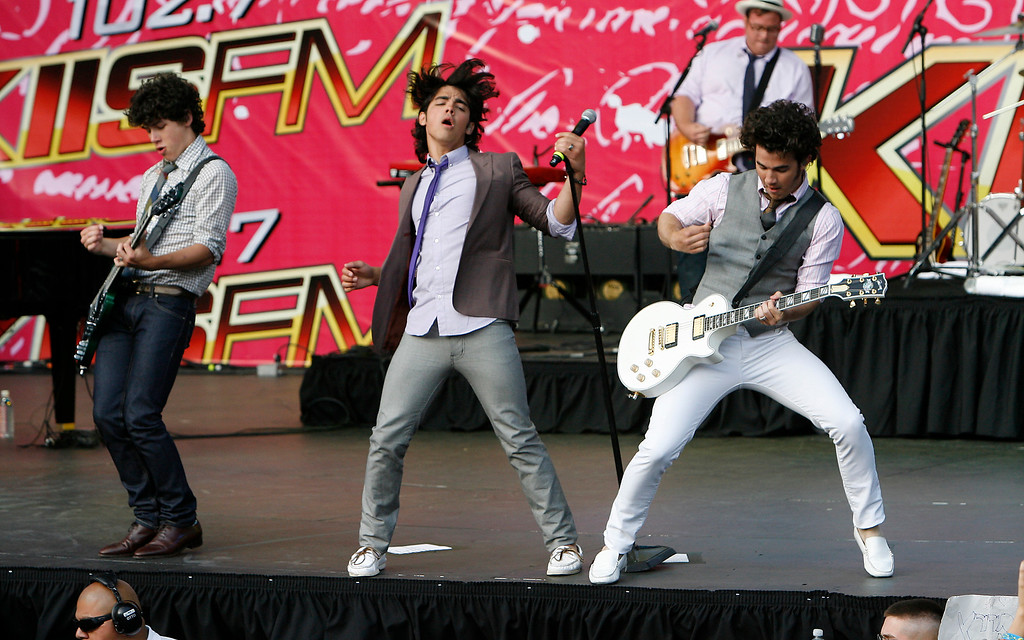 . (left to right) Nick, Joe and Kevin Jonas of the group the Jonas Brothers perform at 102.7 KIIS-FM\'s Wango Tango concert Saturday, May 10, 2008, in Irvine, Calif. (AP Photo/Gus Ruelas)