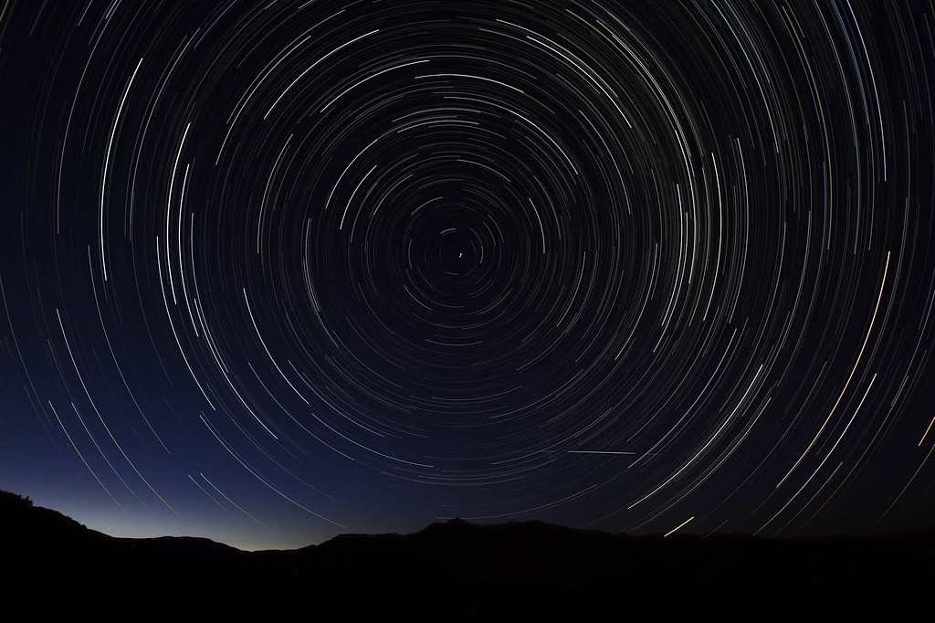 . A multiple exposure picture taken in the early hours of August 11, 2013 shows a Perseids meteor shower in the sky, near the municipality of La Hiruela, on the mountains of the Sierra Norte de Madrid. DANI POZO/AFP/Getty Images