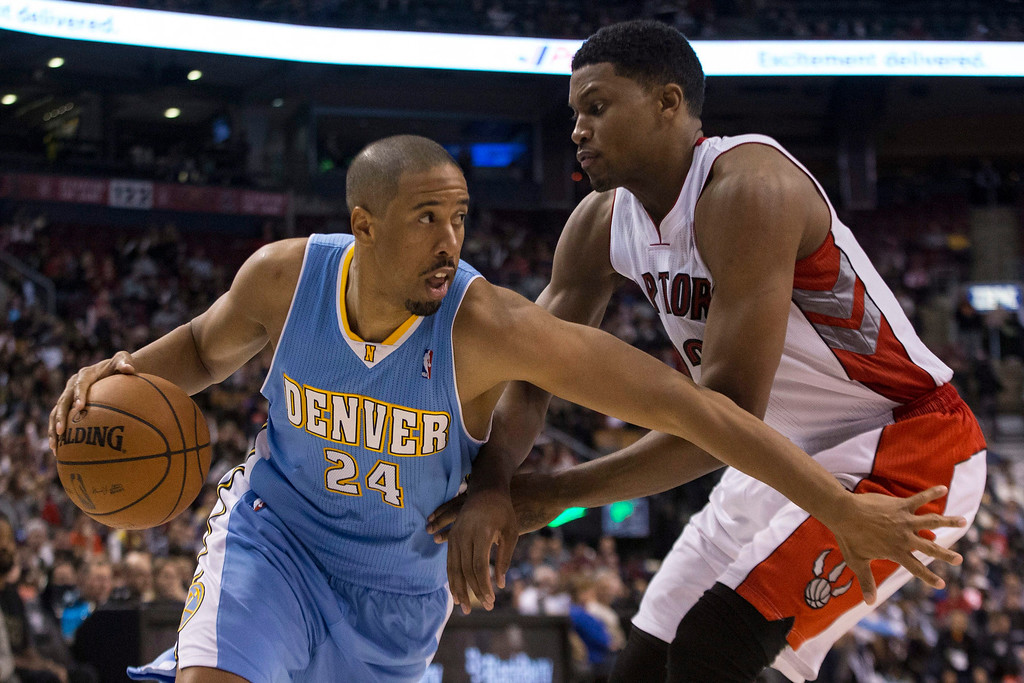 . Denver Nuggets\' Andre Miller drives past Toronto Raptors\' Rudy Gay during the first half of an NBA basketball game on Sunday, Dec. 1, 2013, in Toronto. (AP Photo/The Canadian Press, Chris Young)