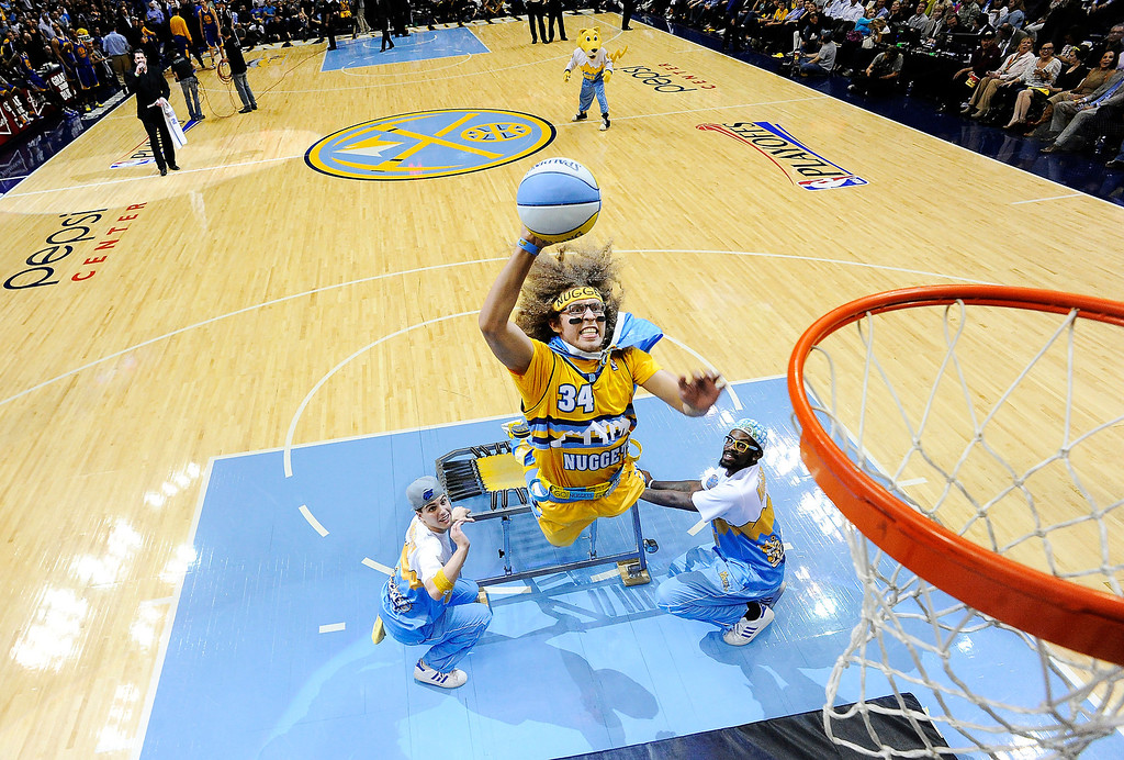 . Nuggets fan Caleb Wittman, 21, of Arvada, gets a chance to attempt a dunk from a trampoline during halftime. The Denver Nuggets took on the Golden State Warriors in Game 5 of the Western Conference First Round Series at the Pepsi Center in Denver, Colo. on April 30, 2013. (Photo by John Leyba/The Denver Post)