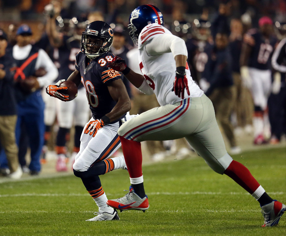 . Defensive back Zack Bowman #38 of the Chicago Bears runs after intercepting a pass in the first quarter against the New York Giants during a game at Soldier Field on October 10, 2013 in Chicago, Illinois.  (Photo by Jonathan Daniel/Getty Images)
