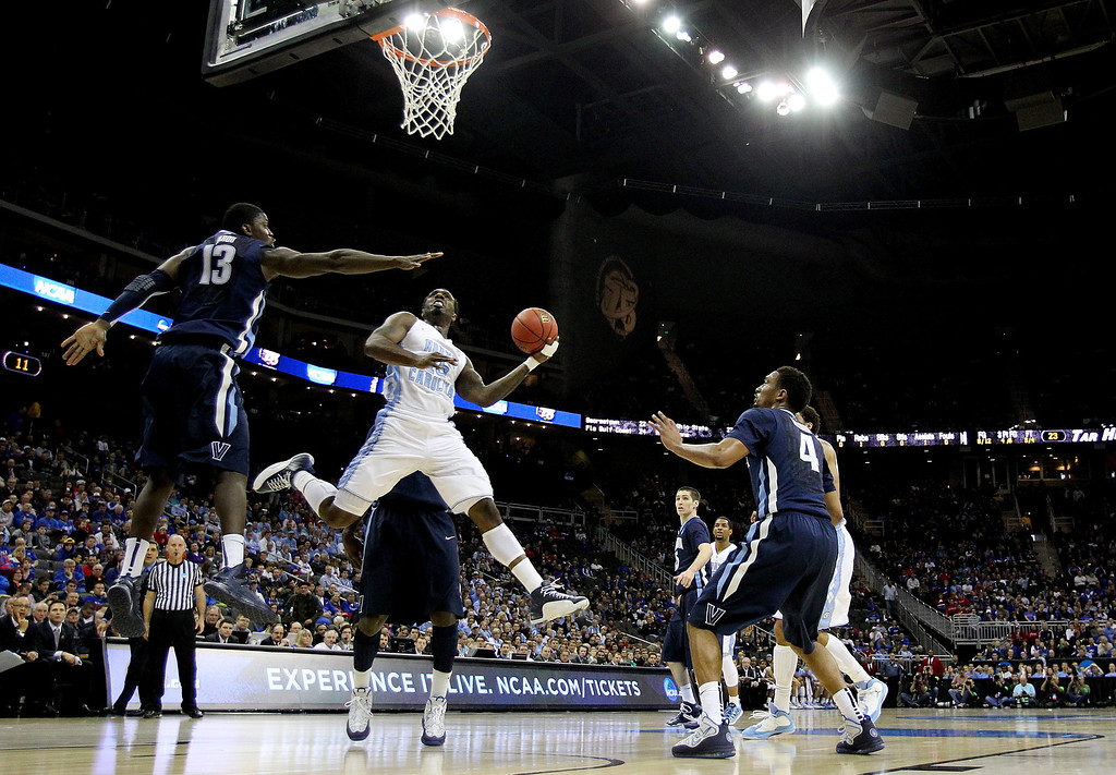 . KANSAS CITY, MO - MARCH 22: P.J. Hairston #15 of the North Carolina Tar Heels shoots against Mouphtaou Yarou #13 of the Villanova Wildcats in the first half during the second round of the 2013 NCAA Men\'s Basketball Tournament at the Sprint Center on March 22, 2013 in Kansas City, Missouri. North Carolina won 78-71.  (Photo by Jamie Squire/Getty Images)