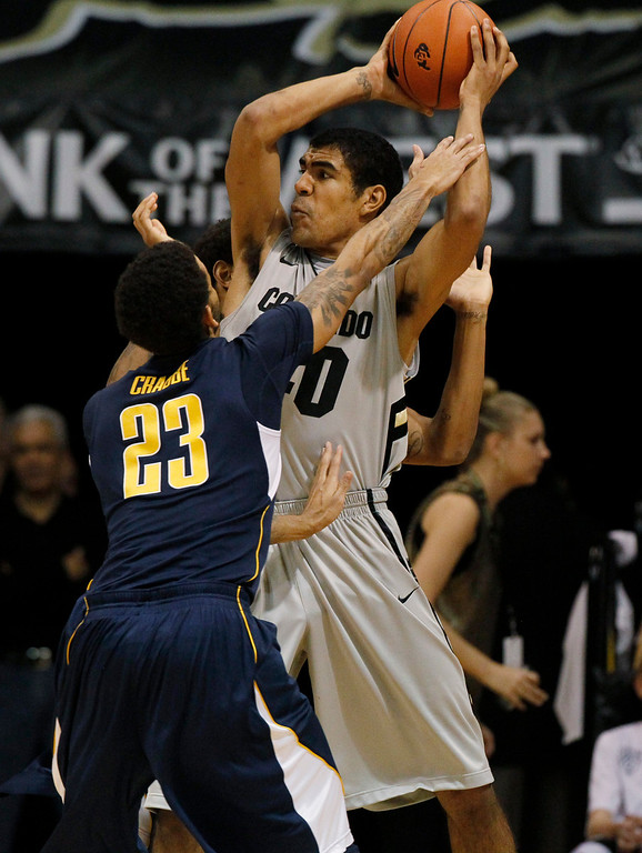 . California guard Allen Crabbe, left, reaches up for the ball as Colorado forward Josh Scott looks to pass in the second half of Colorado\'s 81-71 victory in an NCAA basketball game in Boulder, Colo., Sunday, Jan. 27, 2013. (AP Photo/David Zalubowski)