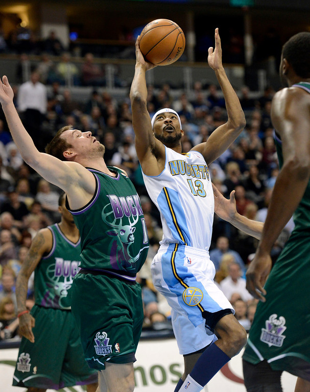. DENVER, CO. - FEBRUARY 05: Corey Brewer (13) of the Denver Nuggets drives on Beno Udrih (19) of the Milwaukee Bucks for a basket during the first quarter February 05, 2013 at Pepsi Center. The Denver Nuggets take on the Milwaukee Bucks in NBA action. (Photo By John Leyba/The Denver Post)