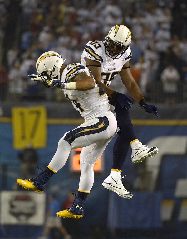 . Ryan Matthews #24 of the San Diego Chargers celebrates with teammate  Antonio Gates #85  after scoring a touchdown against the Houston Texans on September 9, 2013 at Qualcomm Stadium in San Diego, California. (Photo by Donald Miralle/Getty Images)