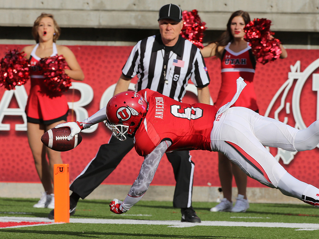 . SALT LAKE CITY, UT - OCTOBER 12: Dres Anderson #6 of the Utah Utes dives into the end sone after catching a pass during the first half of an NCAA football game against the Stanford Cardinal October 12, 2013 at Rice Eccles Stadium in Salt Lake City, Utah. (Photo by George Frey/Getty Images)