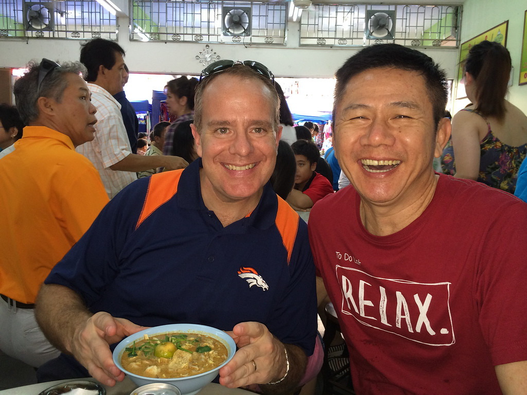 . Enjoying a bowl of curry laksa before the Broncos-Raiders game in Malaysia.