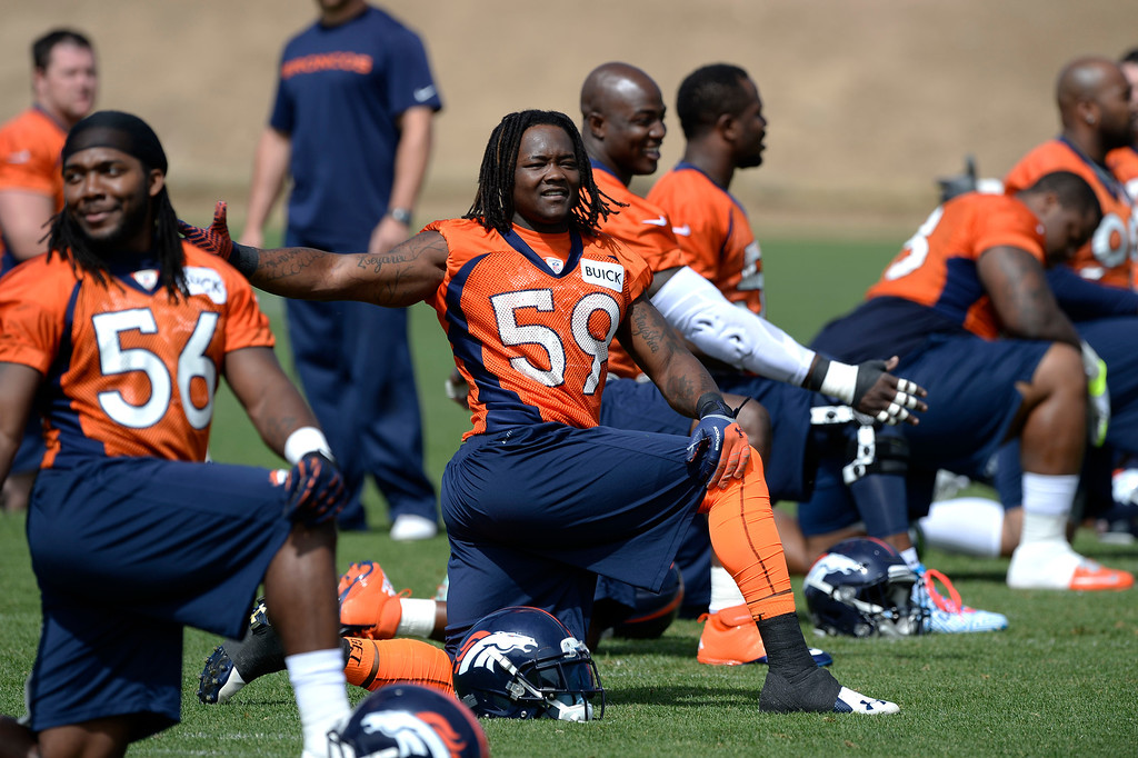 . Denver Broncos LB Danny Trevathan (59) stretches before the start of OTAs June 16, 2014 at Dove Valley. (Photo by John Leyba/The Denver Post)