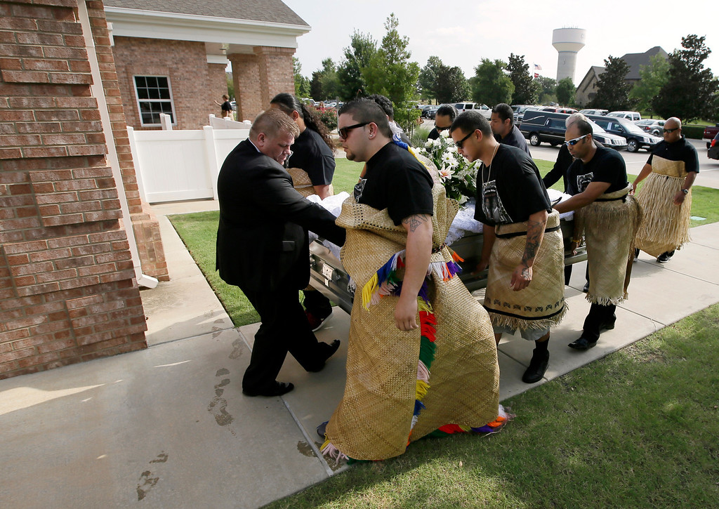 """. The casket of Texas A&M redshirt freshman Polo Manukainiu is led in to the Church of Jesus Christ Of Latter Day Saints before a funeral service for  Manukainiu and his brother Andrew Uhatafe, Saturday, Aug. 10, 2013, in Colleyville, Texas. The two were killed in a single car accident in Northern New Mexico, July 29. Also killed was 18-year-old Utah recruit Gaius \""""Keio\"""" Vaenuku. (AP Photo/Tony Gutierrez)"""