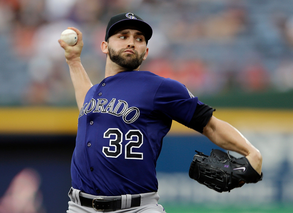 . Colorado Rockies starting pitcher Tyler Chatwood (32) works in the first inning of a baseball game against the Atlanta Braves in Atlanta, Wednesday, July 31, 2013. (AP Photo/John Bazemore)