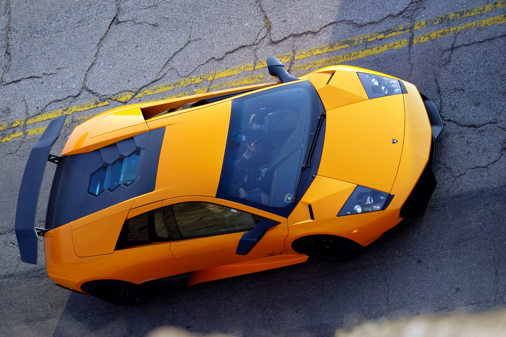 . The new 2010 Lamborghini Murcielago LP 670-4 SuperVeloce leaves Santa Monica Beach on the way to an inaugural opening ceremony of the Automobili Lamborghini Boutique at Westfield Topanga Shopping Center on Wednesday, Dec. 2, 2009, in Santa Monica, Calif.  (AP Photo/Damian Dovarganes)
