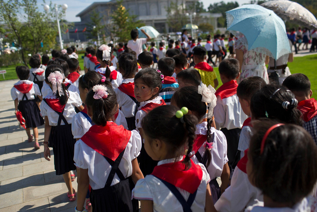 . North Korean school children tour the Kumsusan Palace of the Sun, the mausoleum where the bodies of the late leaders Kim Il Sung and Kim Jong Il lie embalmed, in Pyongyang on Thursday, July 25, 2013. (AP Photo/David Guttenfelder)