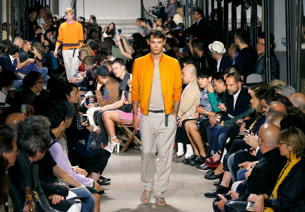 . Models wear creations as part of Hermes men\'s Spring-Summer 2015 fashion collection, presented Saturday, June 28, 2014 in Paris. (AP Photo/Jacques Brinon)