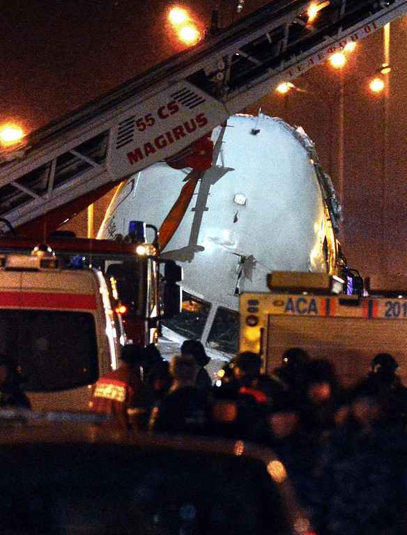 . A crane removes the cabin of the Tu-204 jet from the crash site near the Vnukovo airport outside Moscow on December 29, 2012. Four crew were killed when a Russian airliner crashed into a motorway and broke up into three pieces after overshooting the runway at an international Moscow airport. The Red Wings airlines Russian-made Tu-204 jet -- empty of passengers and carrying just its eight crew on a return trip from the Czech Republic -- caught fire after crashing through the perimeter fence of Vnukovo airport in the west of the city.     NATALIA KOLESNIKOVA/AFP/Getty Images